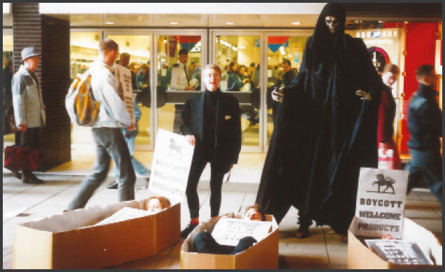 image of Machester ACT UP action against the high prices charged by Burroughs Wellcome for anti-retrorviral therapies, 1992